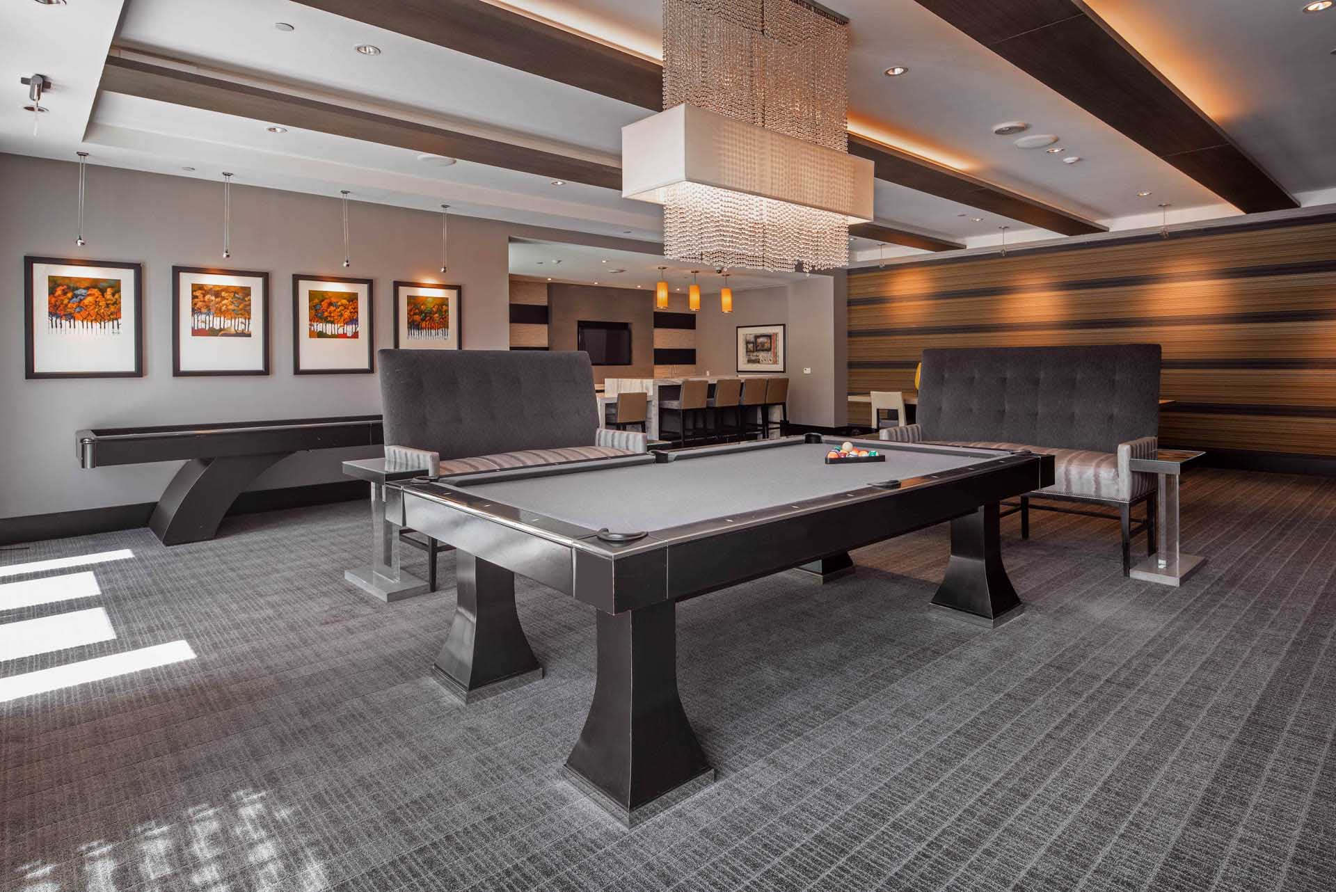 Gaming area of resident lounge with pool table and shuffleboard