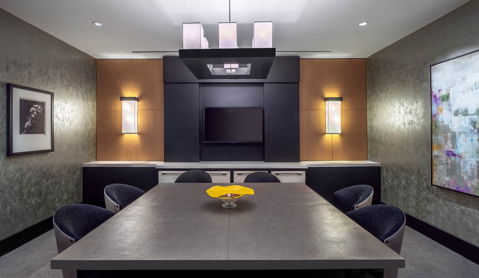 New meeting room with large conference table and TV